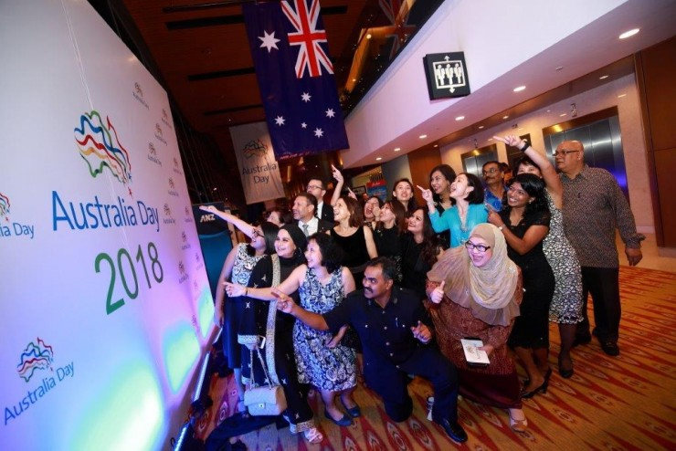 Australian High Commissioner to Malaysia, HE Andrew Goledzinowski and a group of guests admiring the Australia Day 2018 backdrop.