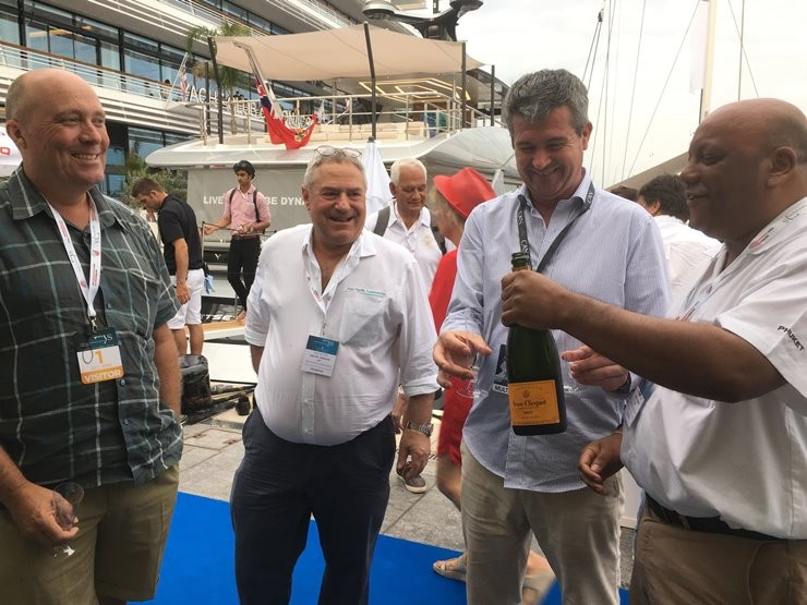 Gordon Fernandes and Scott Walker welcoming MYS attendees outside the APS exhibit stand from last year's show in Monaco