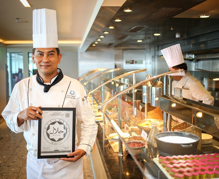 Executive Chef Saifol of Genting Dream with the Halal certification by the Department of Islamic Development Malaysia (Jakim) at the Halal section at The Lido on board Genting Dream homeported in Singapore.