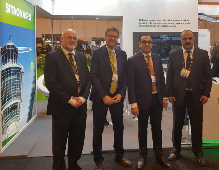Patrick Geurts, Senior Manager, ATM Business Development, and Stephan Egli, Vice President EMEA, of SITAONAIR, with AZANS Director Farhan Guliyev and Agabek Balabekov, Deputy Head of Airspace Efficiency, at World ATM Congress 2019 in Madrid (CREDIT: SITAONAIR)