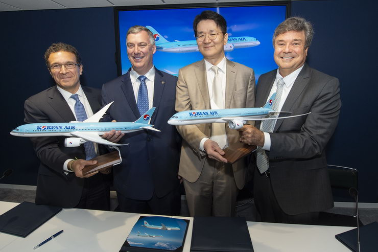 L-to-R: Boeing Commercial Airplanes Vice President Ihssane Mounir, Boeing Commercial Airplanes CEO Kevin McAllister, Korean Air CEO Walter Cho and Air Lease Corporation CEO John Plueger pose with models of Boeing 787 Dreamliner at an MOU signing ceremony during the 2019 Paris Air Show at Le Bourget Airport near Paris, France on June 18, 2019.