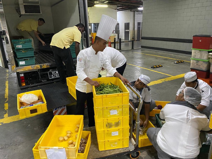 The Kuala Lumpur Convention Centre's Culinary team loading the 340kgs of surplus food, which was recently donated to the Food Aid Foundation to help feed and nourish people in need in Kuala Lumpur.