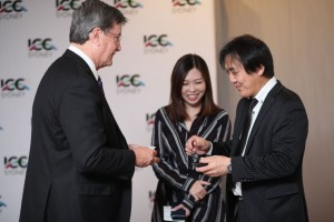 ICC Sydney CEO Geoff Donaghy shares business card with Tokyo guest.