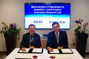Mr Kevin Shum, Director-General of CAAS and Mr Jean Ferré, Vice President, Air Traffic Management of Thales at the signing ceremony.