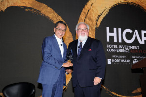 Banyan Tree Holdings Founder and Executive Chairman Mr Ho Kwon Ping receiving the HICAP Award from The BHN Group President Mr Jeff Higley.