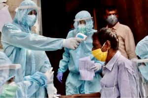 Indian officials in full hazmat protective suits test Delhi residents as Covid-19 infections skyrocket