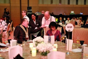 (Seated left) Thomas Gugler, President of World Association of Chefs Societies (W.A.C.S) and (standing right) Andy Cuthbert, Chairman of Worldchefs Congress & Expo share a moment with Mary Clare, the Kuala Lumpur Convention Centre's Assistant Catering Manager, during the Gala Dinner of Worldchefs Congress & Expo 2018